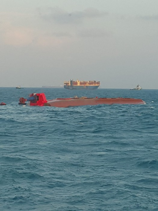 Cable ship capsizes after collision with tanker near