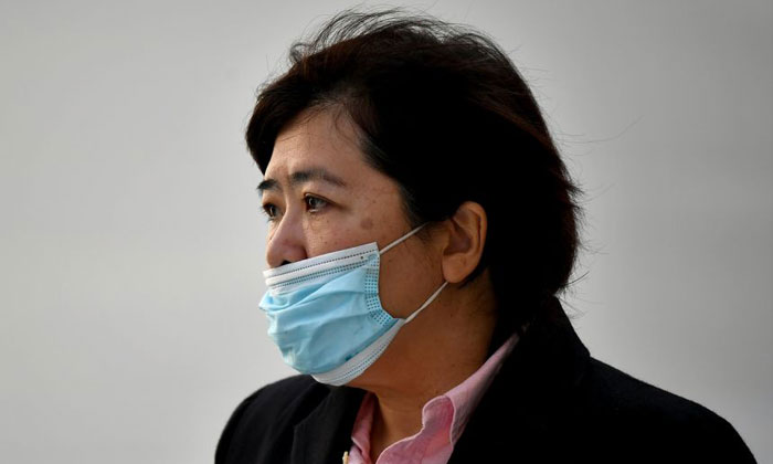 Phoon Chiu Yoke leaving the State Courts on June 15, 2021. She now faces a total of 22 charges. PHOTO: ST FILE